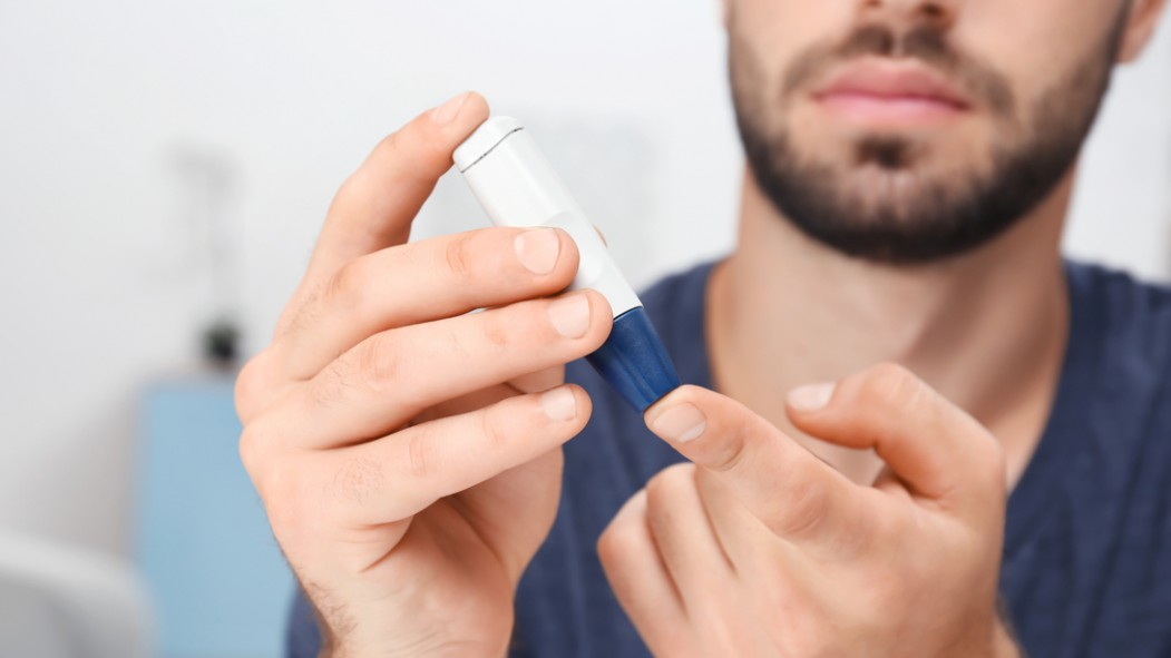 Man-With-Beard-Pricking-Finger-For-Blood-Diabetes-Test thumbnail