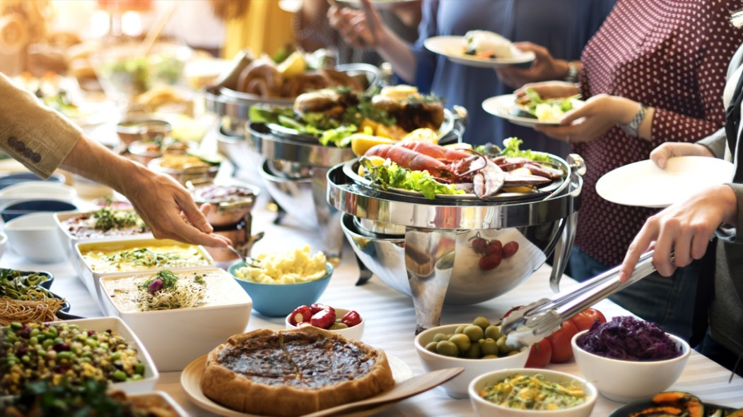 Many-People-On-Buffet-Line-Serving-Food thumbnail