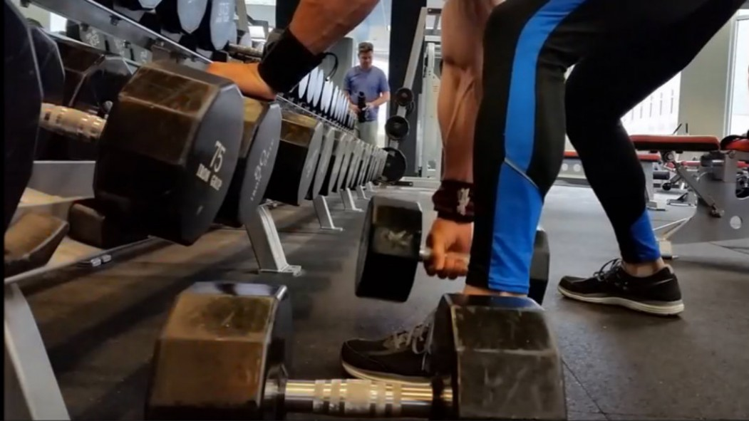 rows at dumbbell rack Video Thumbnail
