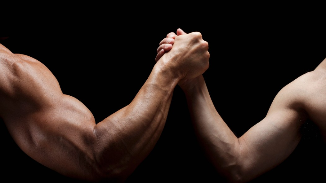 A picture of a man with a muscular arm and a man with a less-muscular arm. thumbnail