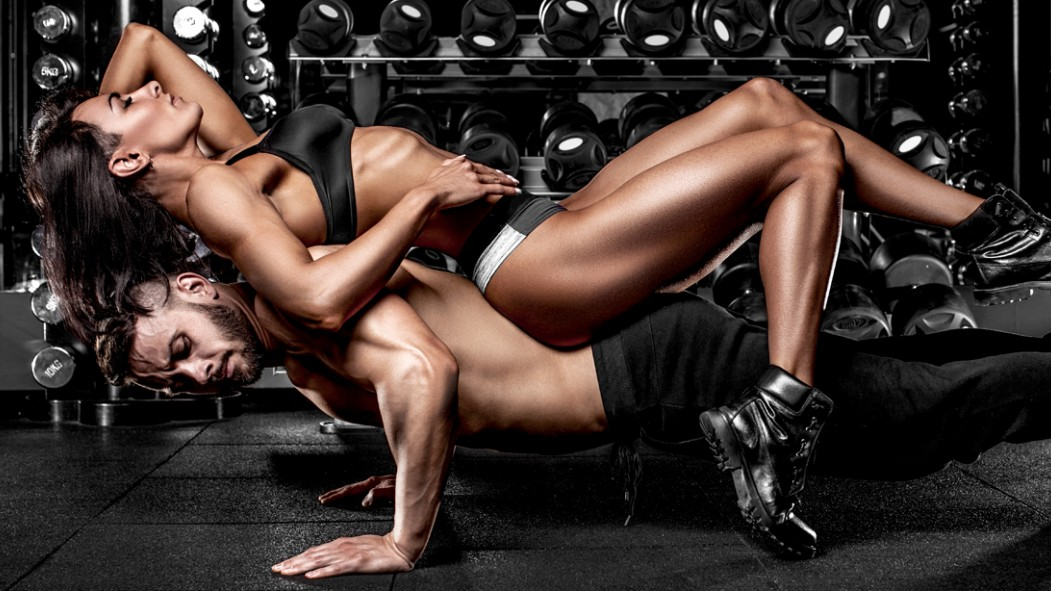 Muscular-Man-Doing-Pushup-With-Sexy-Female-On-His-Back thumbnail