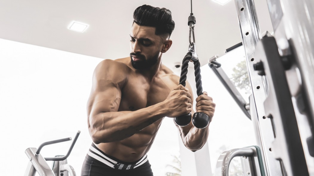 Muscular-Man-Performing-Tricep-Pushdown thumbnail