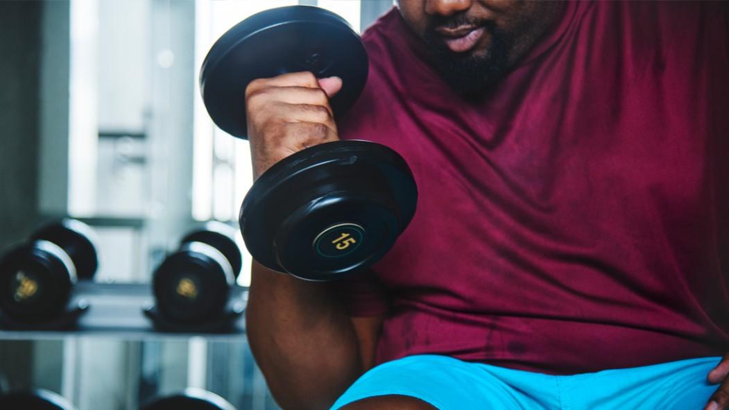 Overweight-Man-Lifting-Lightweight-Dumbbell thumbnail