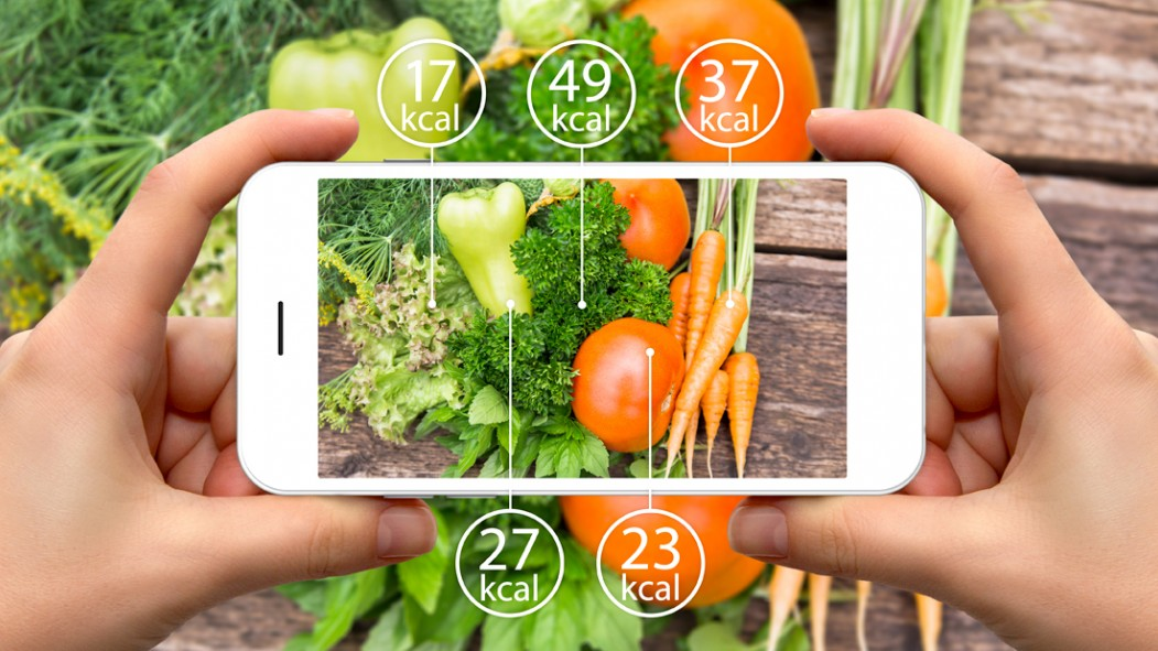 Person-Taking-Photo-Of-Vegetables-On-Iphone-With-Calories-Display thumbnail