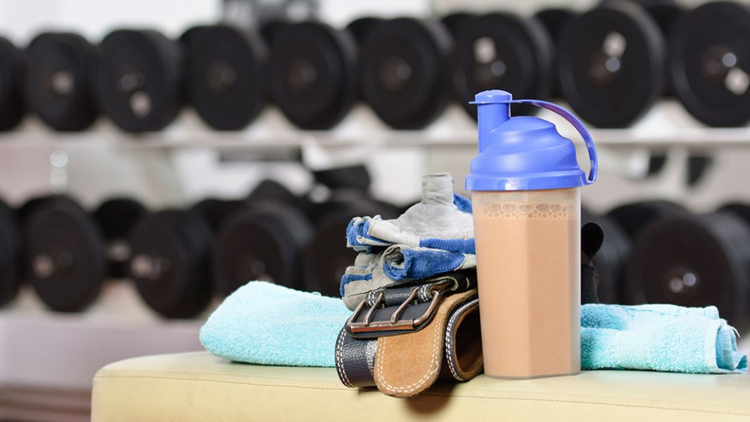 A protein shake on a gym bench.  thumbnail