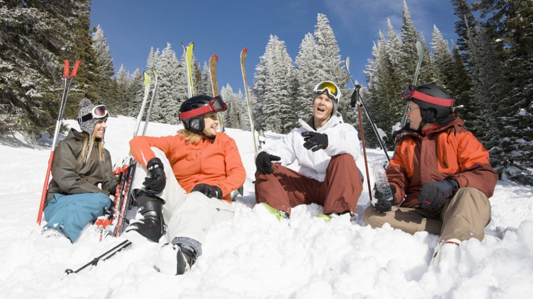 Skiier-Friends-Hanging-Out-In-Snow-Mountain thumbnail