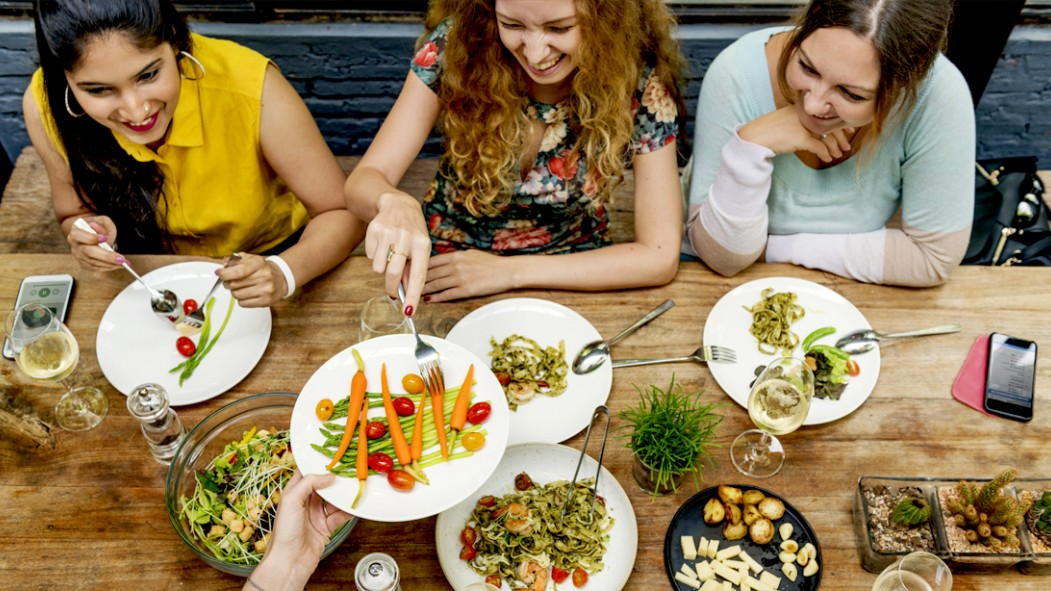 Three-Girls-Sitting-At-Restaurant-Eating-Healthy thumbnail