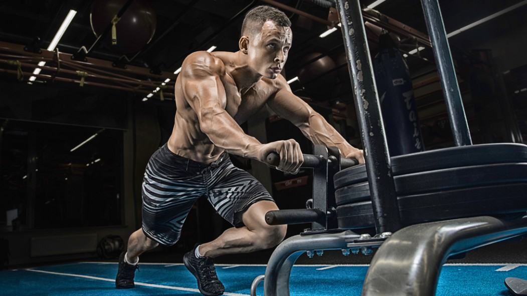 Topless-Muscular-Male-Pushing-Prowler-Sled thumbnail