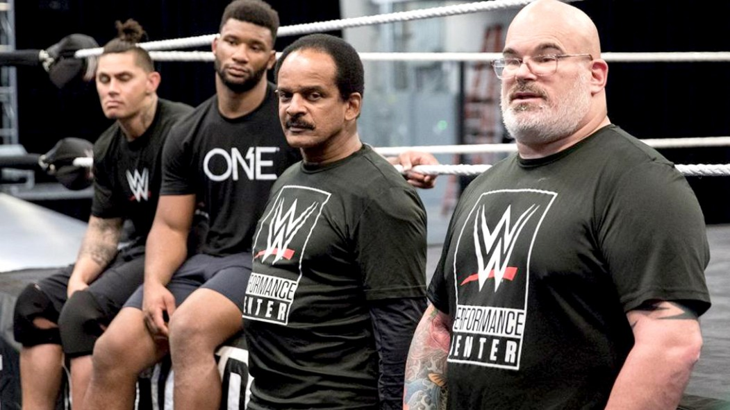 WWE-Trainers-Next-To-Ring thumbnail