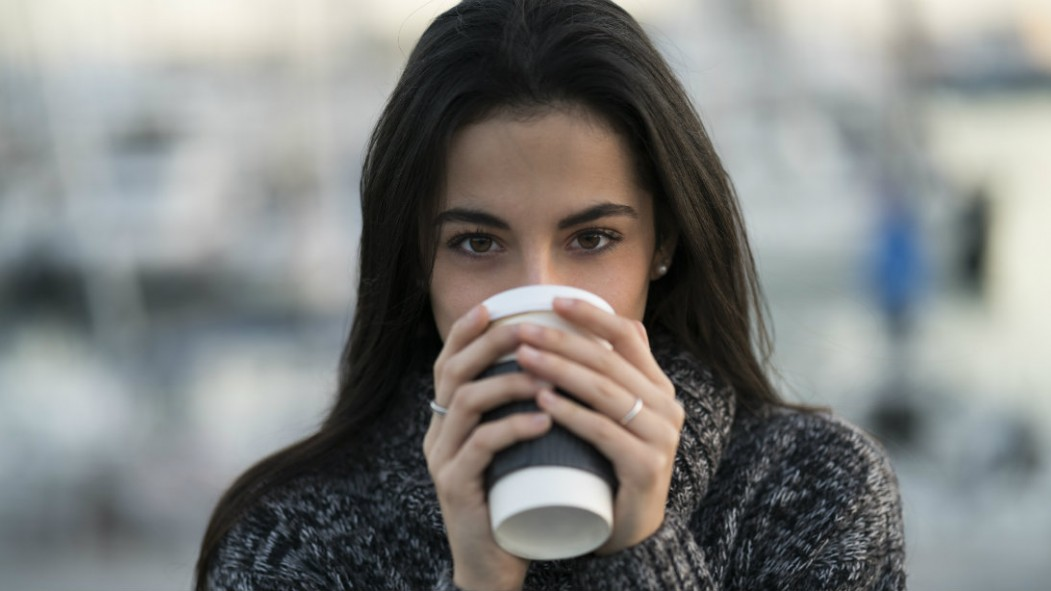 Woman drinking cup of coffee thumbnail