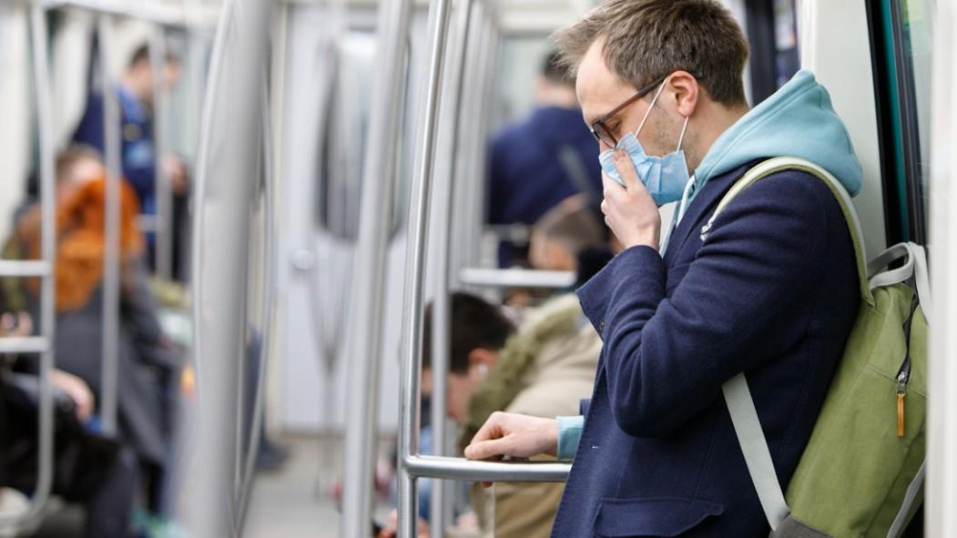 Young-White-Male-Wearing-Medical-Mask-On-Subway-Coronavirus thumbnail