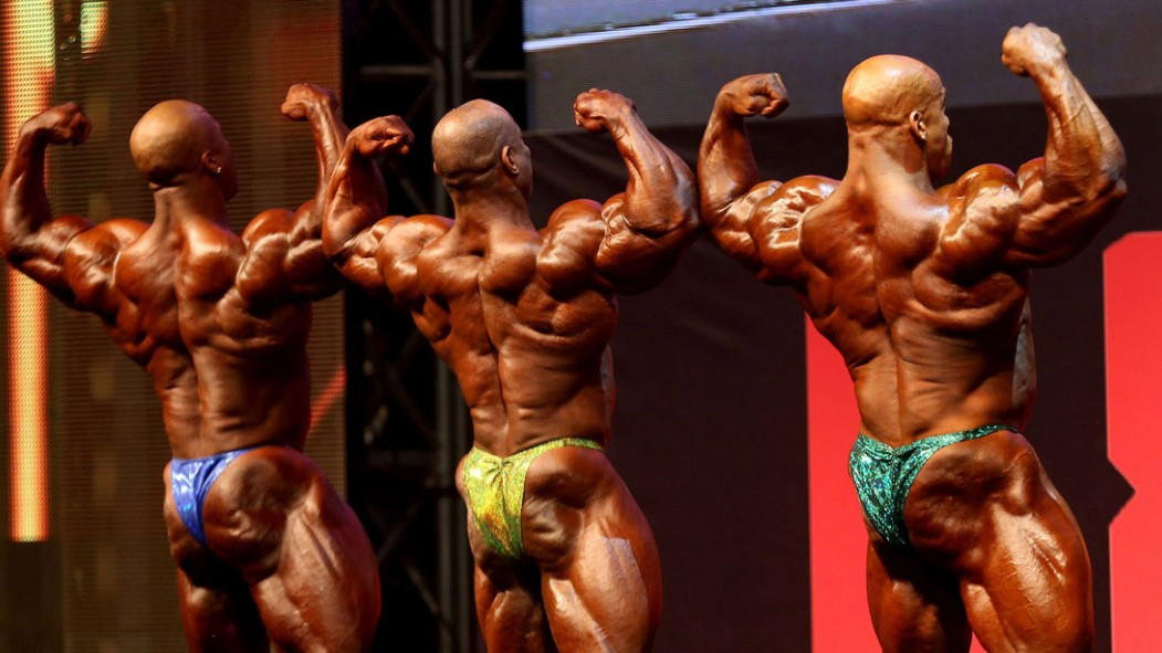 Bodybuilders perform for the judges during the Kuwait Pro bodybuilding tournament in Kuwait City on September 29, 2016. thumbnail