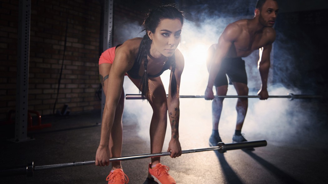 Couple Working Out With Barbells thumbnail