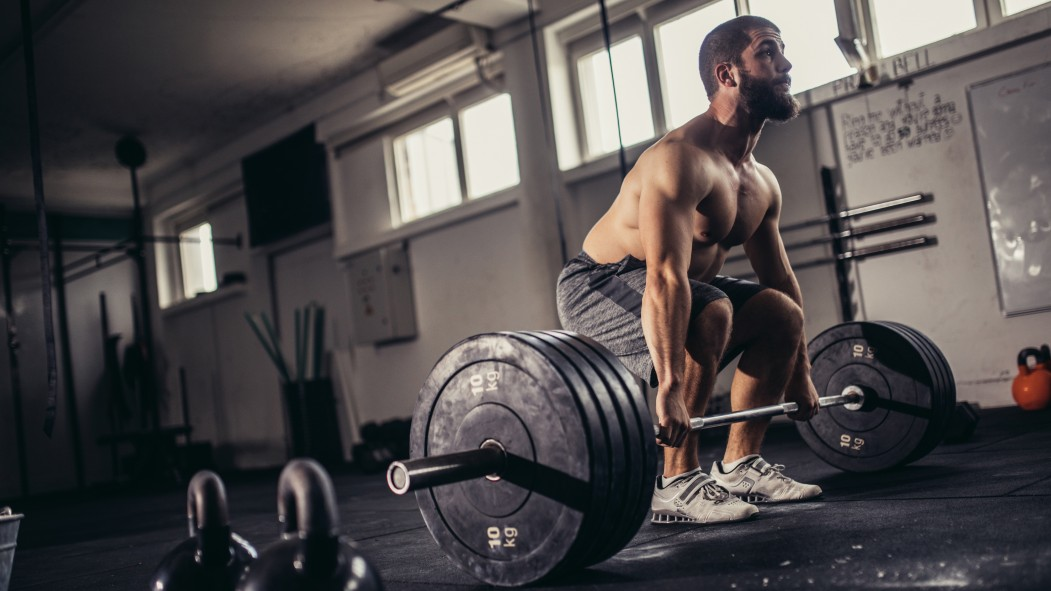 Man Deadlifting in Gym thumbnail