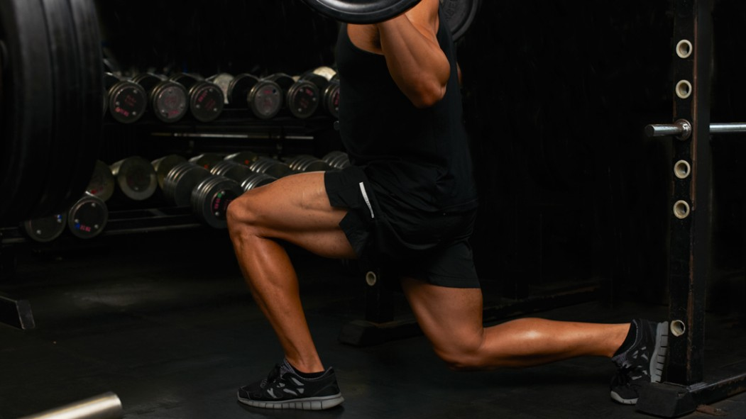 Man Performing Barbell Lunges thumbnail