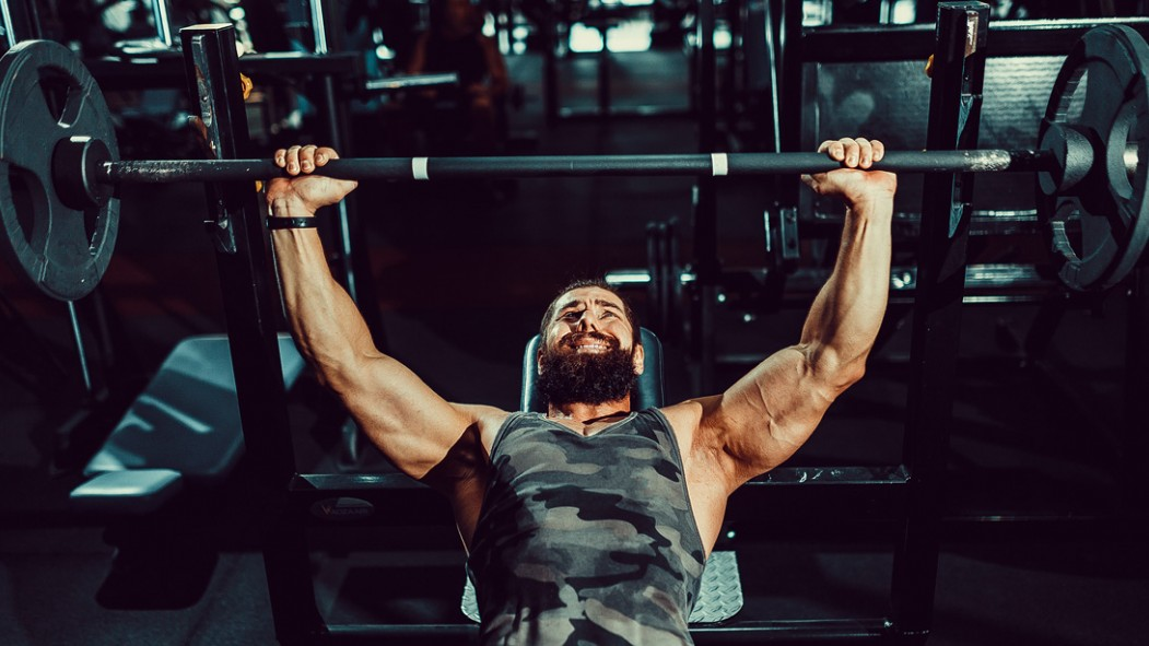 Man Incline Bench Pressing in the Gym thumbnail