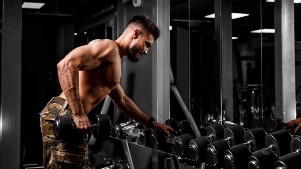 Man Lifting Dumbbells in the Gym thumbnail