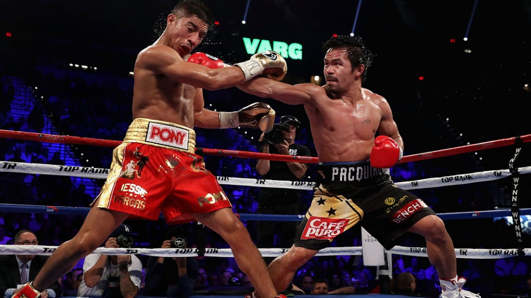 Manny Pacquiao (R) lands a right on Jessie Vargas during their WBO welterweight championship fight at the Thomas & Mack Center on November 5, 2016 thumbnail