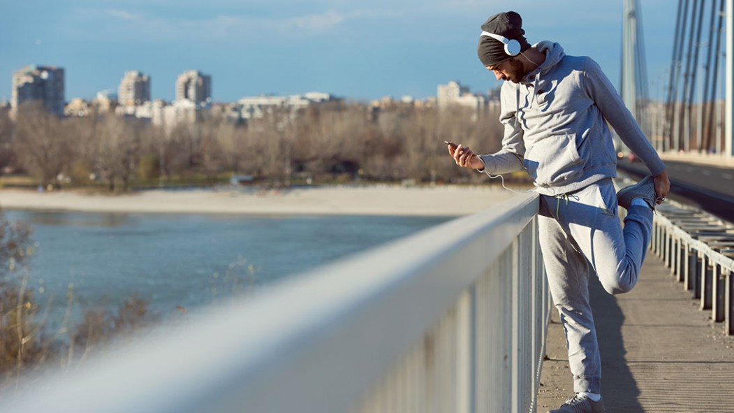 Man Exercising Outdoors On Phone thumbnail