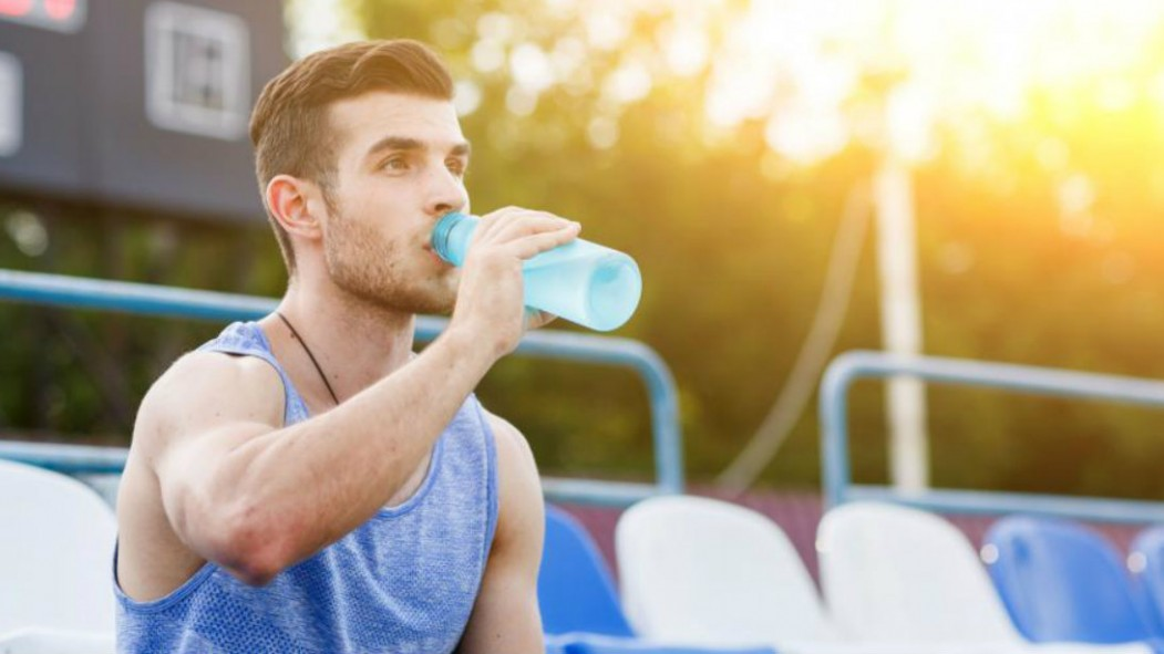 Man Drinking Sports Drink thumbnail