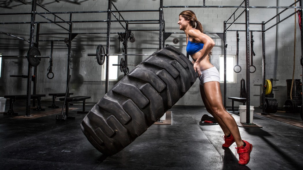 Woman Flipping Tire thumbnail