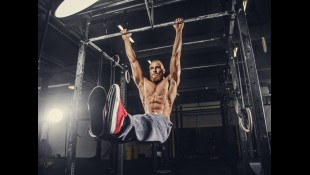 Man Performing Leg Raise on Pullup Bar thumbnail