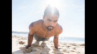 Man Exercising On The Beach  thumbnail