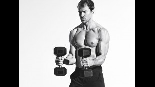 Fitness model holding dumbbells  thumbnail
