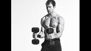 Fitness model holding dumbbells  thumbnail