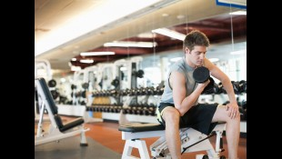 Beginner lifter doing Concentration Curl in the gym thumbnail