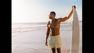 Shirtless Man At The Beach With Surfboard thumbnail