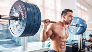 Strong man holding a heavy barbell thumbnail