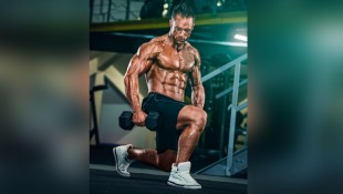 Bodybuilder performing dumbbell lunge thumbnail