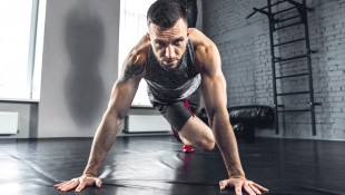 Male-With-Beard-Performing-Pushup-Knee-Tuck thumbnail