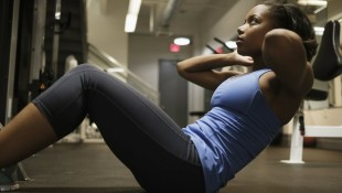 Woman performing situp in gym thumbnail