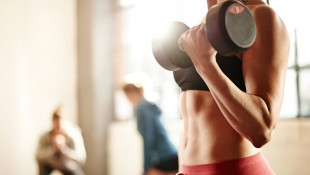 Woman Lifting Weights With Dumbbells thumbnail