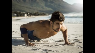 Man doing pushups on the beach thumbnail