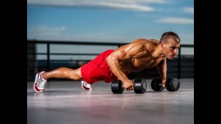 Man doing pushups with dumbbells thumbnail