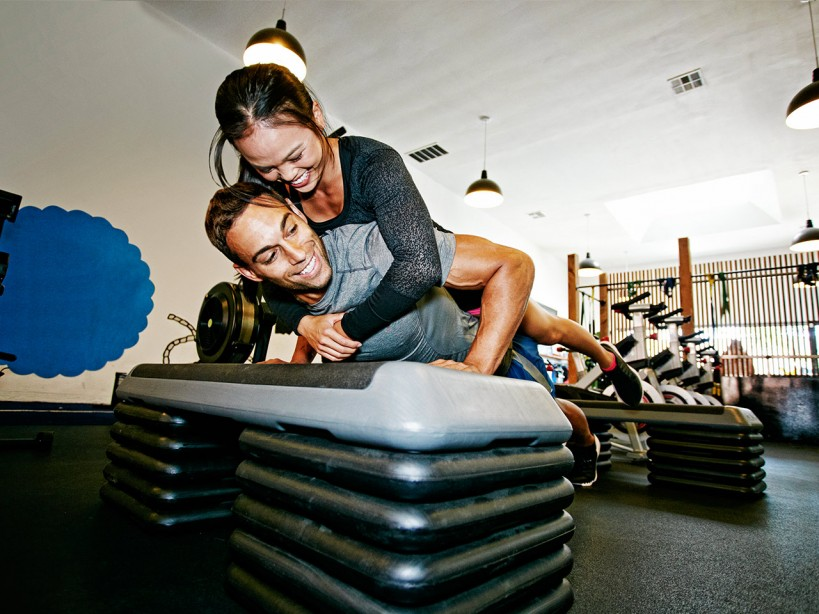 Couple Working Out at the Gym