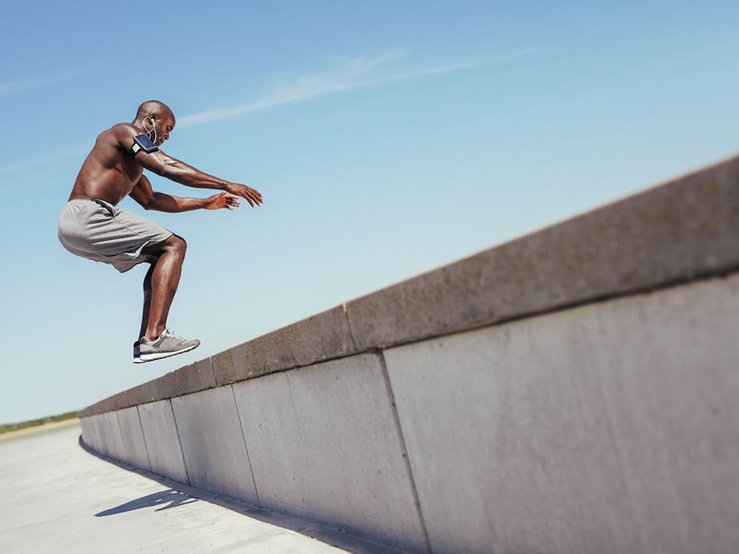 Man Jumping On Ledge For Exercise
