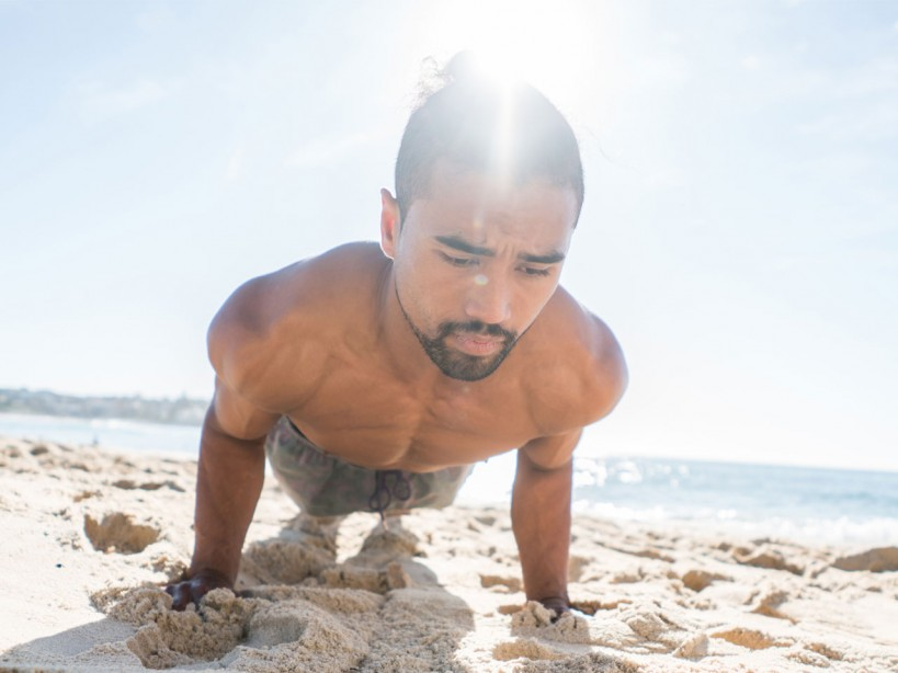 Man Exercising On The Beach