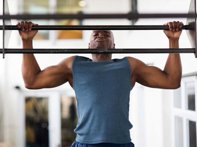 Man Doing Pullup At A Gym