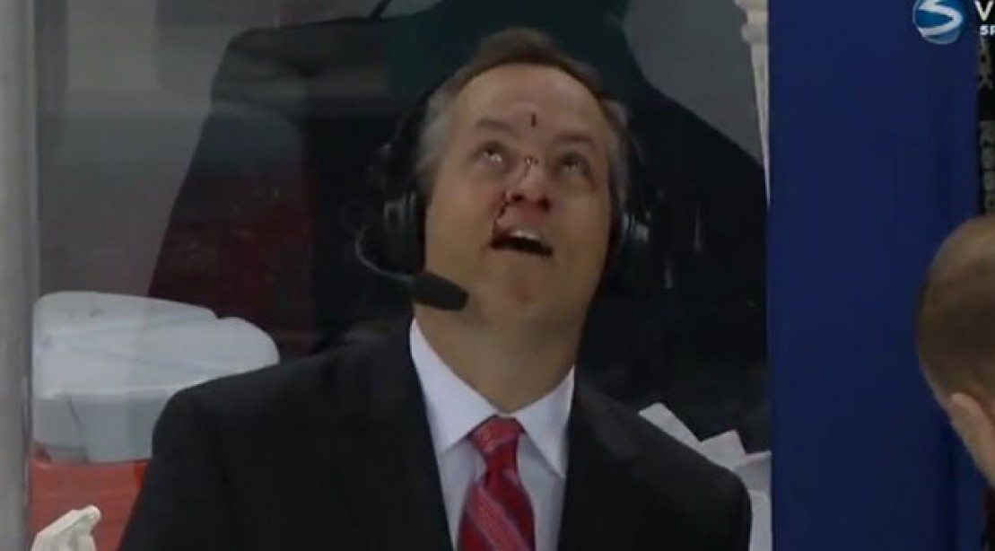 MSG Hockey Announcer Gets a Puck in the Face