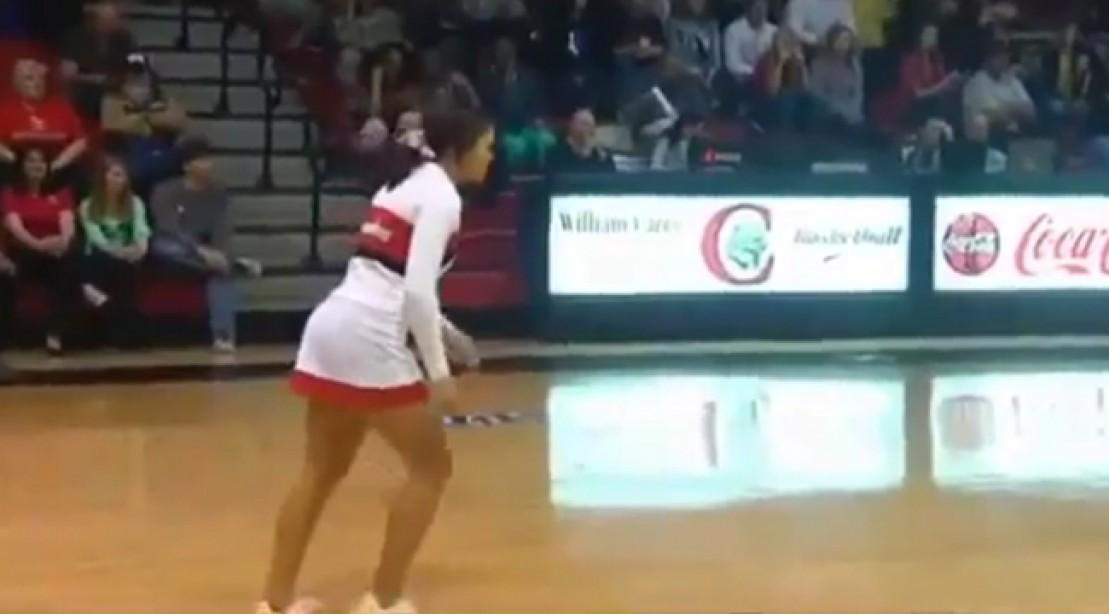 Cheerleader Makes Half-Court Shot Mid-Somersault Look Easy