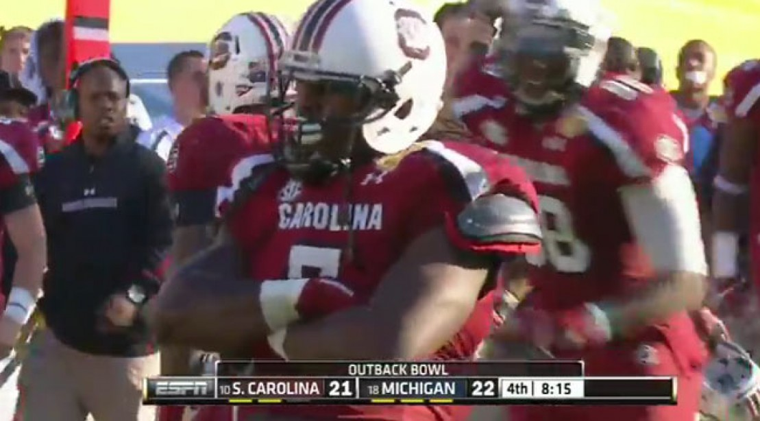 Ouch! Jadeveon Clowney Floors Vincent Smith During the Outback Bowl
