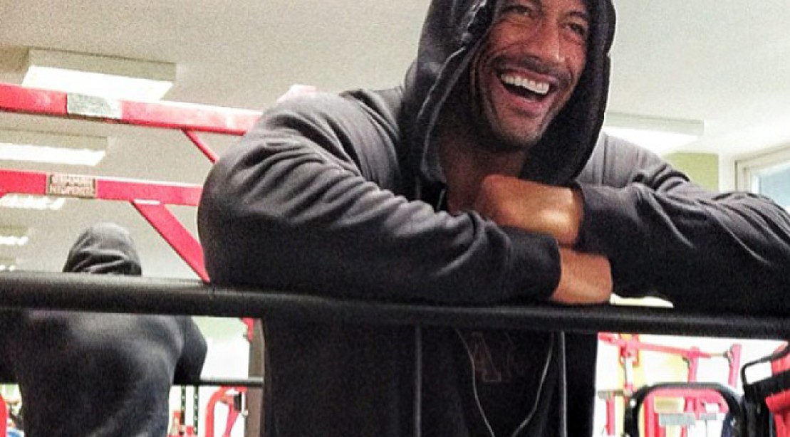 The Rock laughing in the gym.