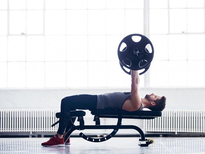 Man performing bench press