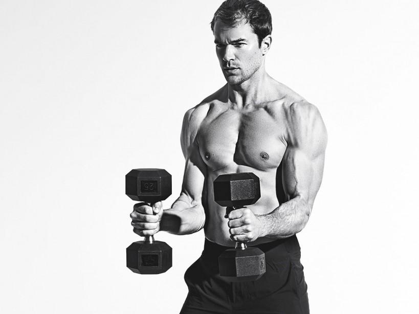 Fitness model holding dumbbells