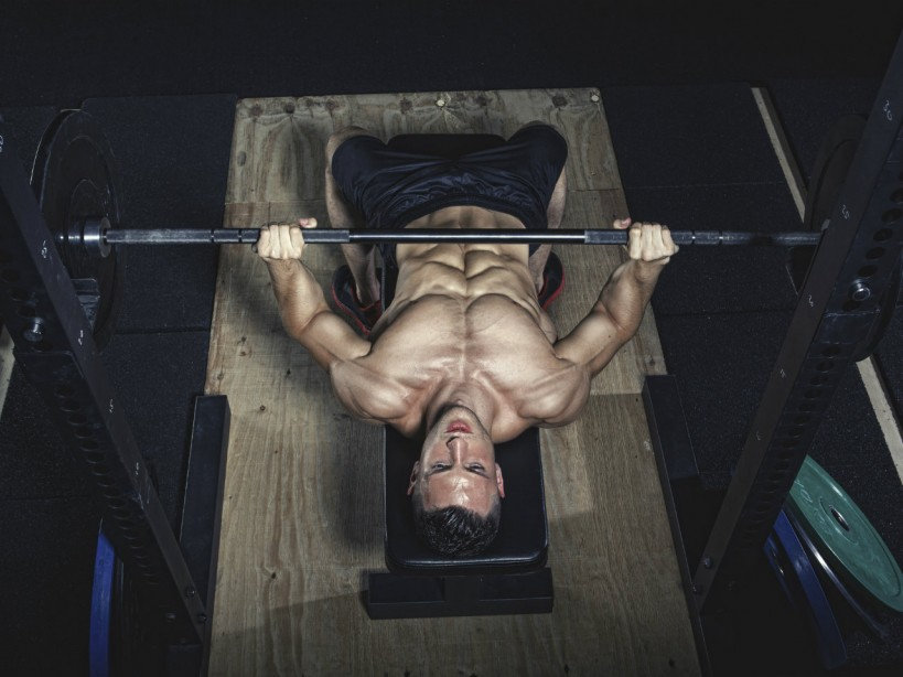 Man performing barbell bench press