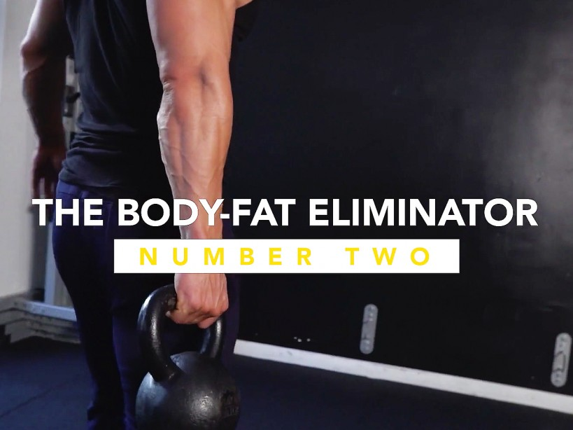 Muscular Man Holds Kettlebell During Fat-Burning Workout
